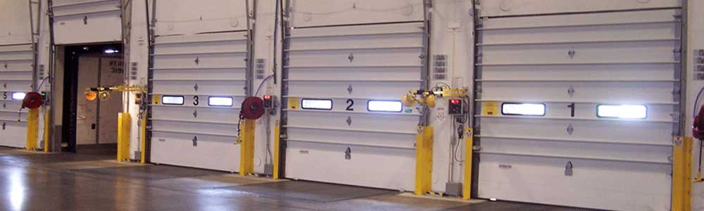 Sectional overhead doors for a commercial loading dock